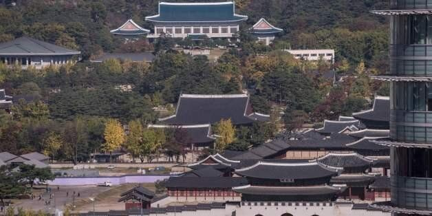 A general view shows Gyeongbokgung palace and the presidential Blue House (top C) in Seoul on November...