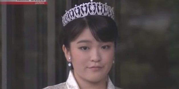 Japan's Princess Mako looks on after cutting the ribbon in the official celebration of the 80th anniversary...