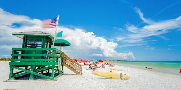A lifeguard tower at an idyllic beach in a sunny summer day. Siesta Key beach at Sarasota, Florida, USA...
