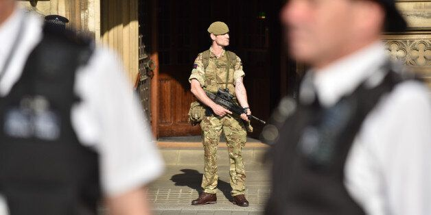 LONDON, UNITED KINGDOM - MAY 24: British Army soldiers seen on duty outside Parliament and Downing Street...