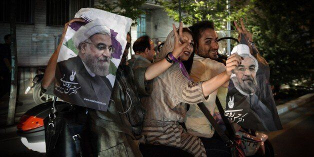TEHRAN, IRAN- MAY 20: Supporters of President Hassan Rouhani celebrate after the results of the Iran...