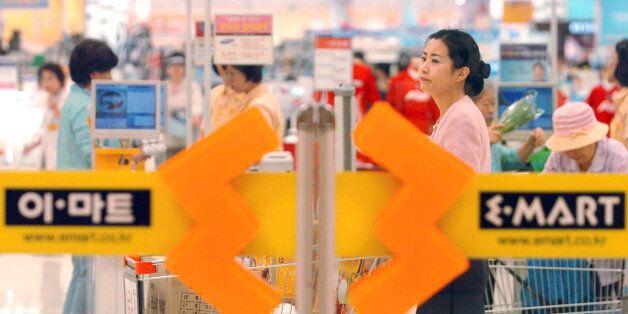 SOUTH KOREA - MAY 24: A South Korean customer shops at E-Mart in Seoul, Korea in Wednesday, May 24, 2006....