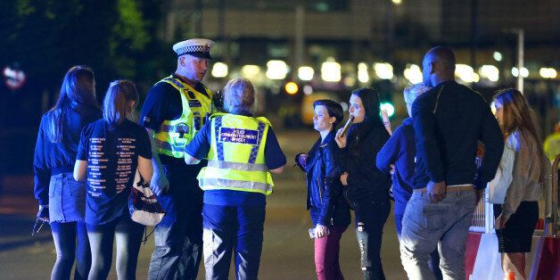 MANCHESTER, ENGLAND - Police and fans close to the Manchester Arena on May 23, 2017 in Manchester, England....