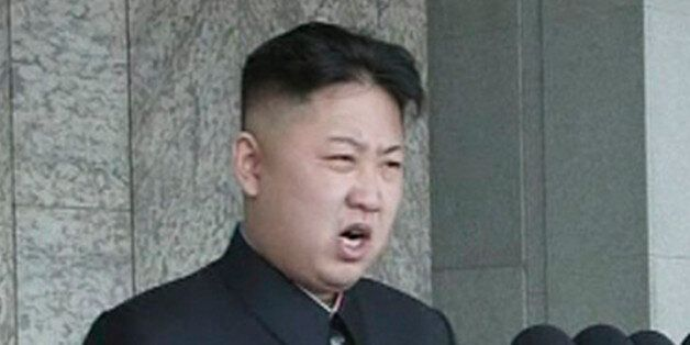 North Korean leader Kim Jong-un speaks during a mass parade to celebrate founder Kim Il-sung's 100th...