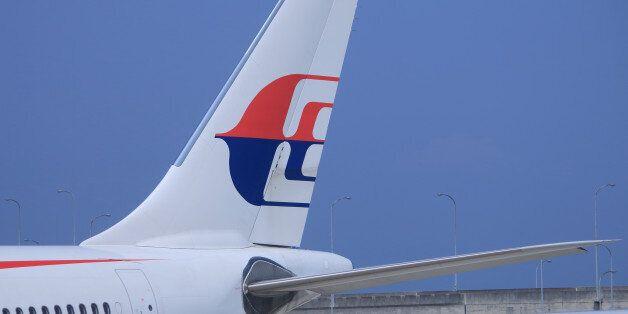 Osaka, Japan - 20 June, 2014: Malaysian airlines airplane parks at Kansai Airport in Osaka