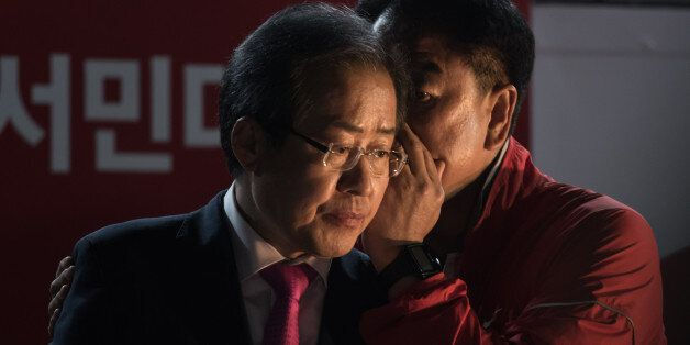 South Korean presidential candidate Hong Jun-Pyo (L) prepares to give a speech during a campaign rally...