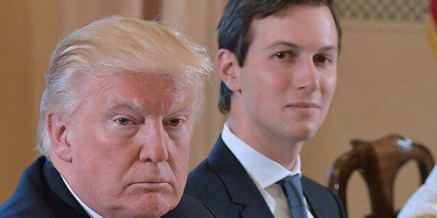 US President Donald Trump (L) and White House senior advisor Jared Kushner take part in a bilateral meeting...