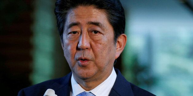 Japan's Prime Minister Shinzo Abe speaks on reports of the launch of a North Korean missile to reporters,...