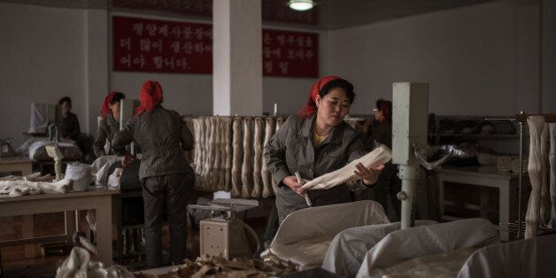 A worker processes silk at the Kim Jong Suk Silk Mill in Pyongyang on February 21, 2017. The Kim Jong...