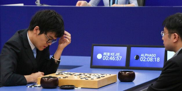 JIAXING, CHINA - MAY 25: Chinese Go player Ke Jie (L) competes against Google's artificial intelligence...