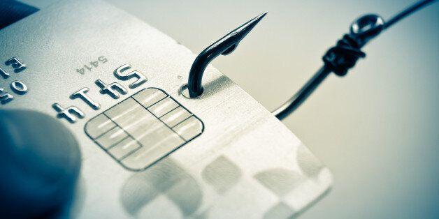 phishing - fish hook and credit