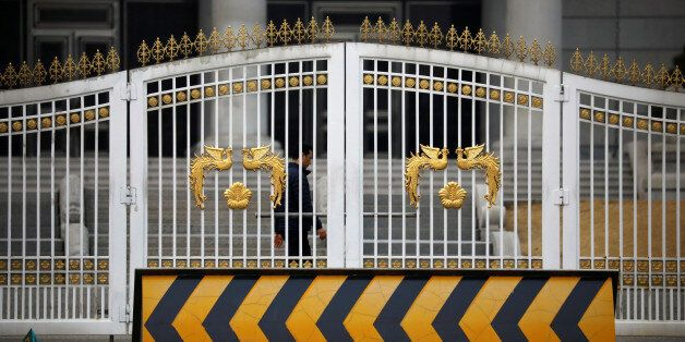 A man walks behind an entrance of the Presidential Blue House before South Korea's ousted leader Park...