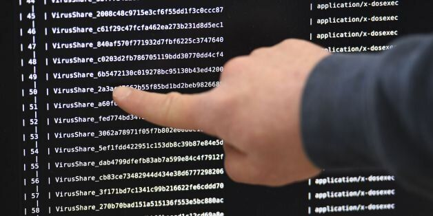 An IT researchers shows on a giant screen a computer infected by a ransomware at the LHS (High Security...