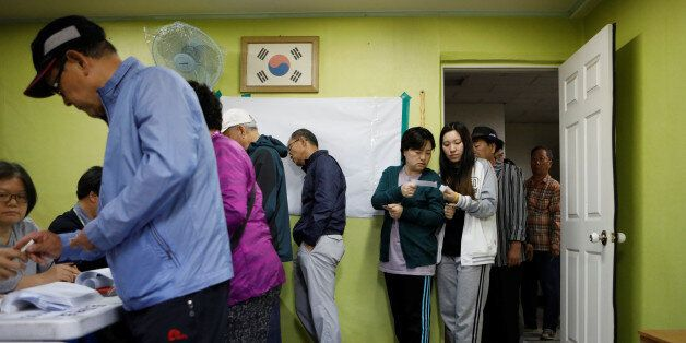 People cast their votes at a polling station during the presidential elections in Seoul, South Korea...
