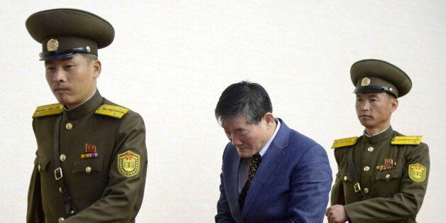 A man (C) who identified himself as Kim Dong Chul, previously said he was a naturalised American citizen...