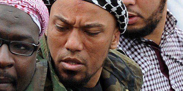 Picture taken on May 5, 2012 shows former German rapper Denis Cuspert (C) among salafi in Bonn, Germany....
