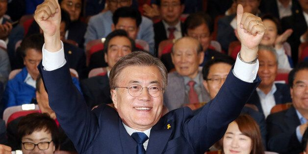 Moon Jae-in, the presidential candidate of the Democratic Party of Korea, speaks to the media after voting...
