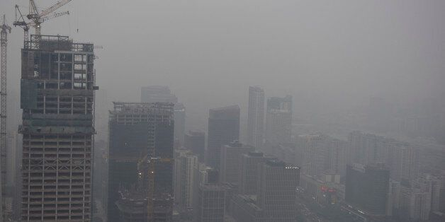 BEIJING, CHINA - APRIL 16: A general view of the centre of Beijing with a heavy cloud of pollution over...
