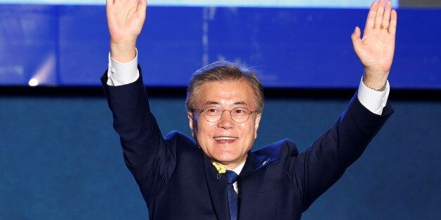 South Korea's president-elect Moon Jae-in celebrates at Gwanghwamun Square in Seoul, South Korea, May...
