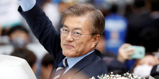 Moon Jae-in, the presidential candidate of the Democratic Party of Korea, leaves after his election campaign...