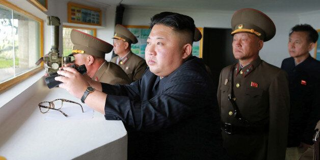 North Korean leader Kim Jong Un inspects the defence detachment on Jangjae Islet and the Hero Defence...