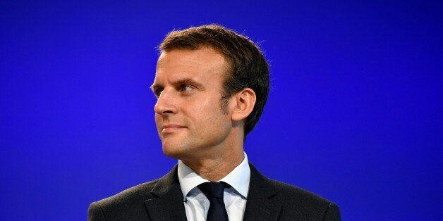 France's former Minister of the Economy Emmanuel Macron looks on after handling over power to French...