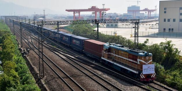A freight train transporting containers laden with goods from London, arrives at Yiwu railway port station...