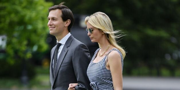 Jared Kushner and Ivanka Trump make their way across the South Lawn to board Marine One at the White...
