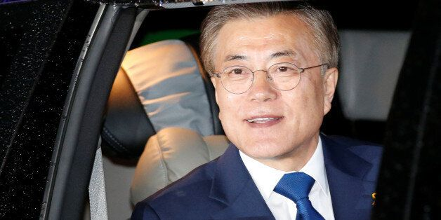 Moon Jae-in, the presidential candidate of the Democratic Party of Korea, leaves his house for his party...