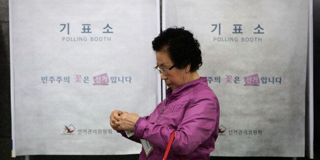 SEOUL, SOUTH KOREA - MAY 04: A South Korean woman leaves after casting her preliminary vote in a polling...
