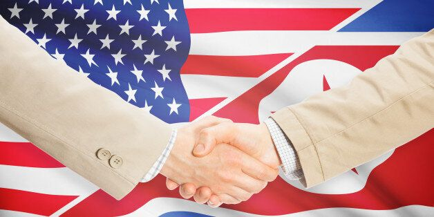 Businessmen shaking hands - United States and North