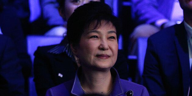 South Korea's president Park Geun-Hye (L) attends a K-Pop concert, the KCON 2016, at the Bercy Arena,...