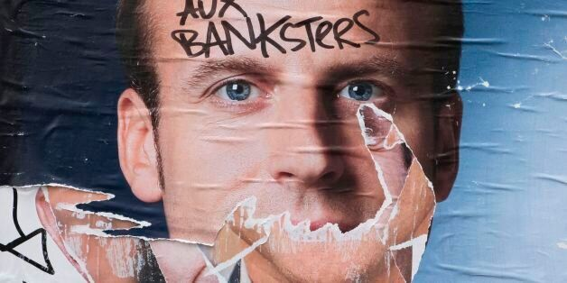 A picture taken on May 8, 2017 shows a vandalised electoral campaign poster of French president-elect...