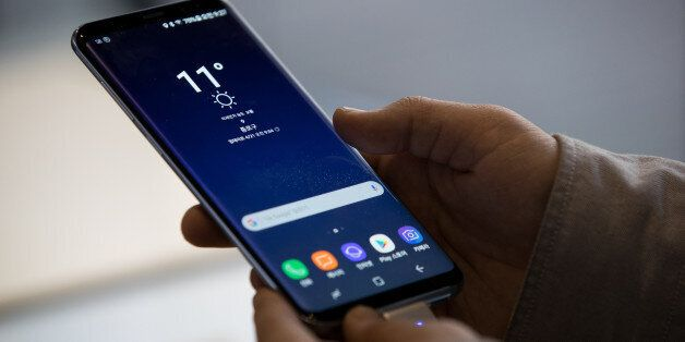 A visitor tries out a Samsung Electronics Co. Galaxy S8 smartphone at KT Corp.'s Olleh Square flagship...