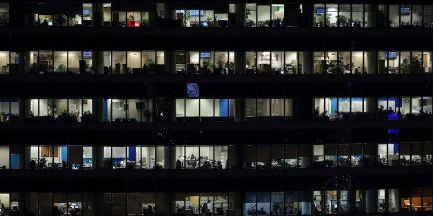 Offices in a building sit illuminated at night in the Gangnam district in Seoul, South Korea, on Monday,...