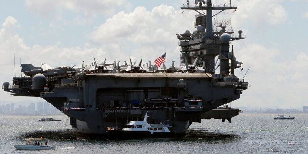 U.S. Navy's USS Carl Vinson aircraft carrier is seen anchored off the Manila bay, west of Manila May...