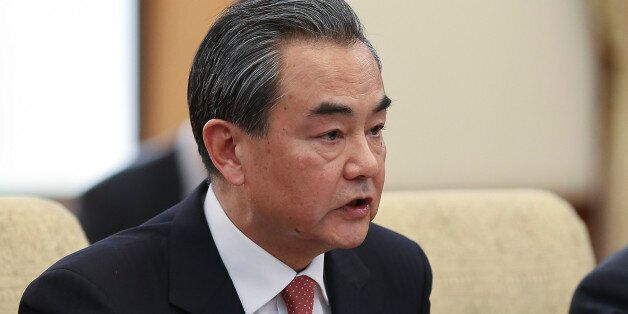 BEIJING, CHINA - MARCH 18: Chinese Foreign Minister Wang Yi (L) during a meeting with U.S. Secretary...