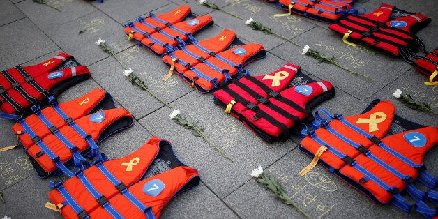 Life vests symbolising the 304 victims of sunken ferry Sewol are placed during a protest demanding South...