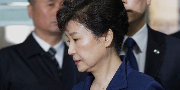 South Korea's ousted president Park Geun-Hye (front) arrives for questioning on her arrest warrant at...