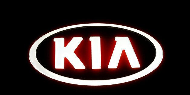 The logo of Kia Motors is seen outside a garage in Vienna, Austria, September 27, 2016. REUTERS/Leonhard