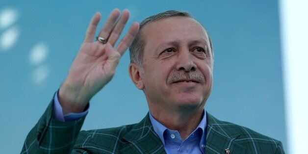 ISTANBUL, TURKEY - APRIL 15: Turkish President Recep Tayyip Erdogan greets the crowd during a meeting...