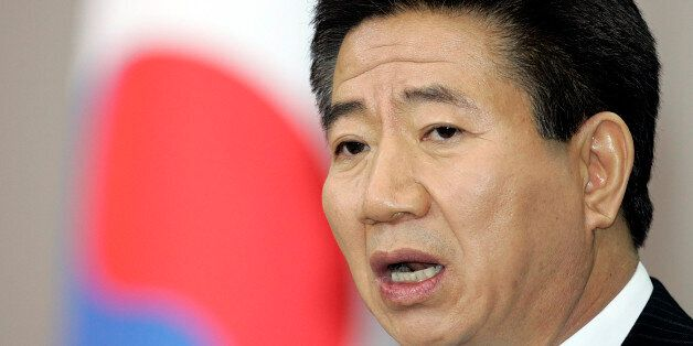 South Korea's President Roh Moo-hyun delivers a speech during a new year news conference in Seoul January...