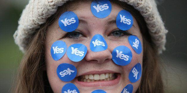 A women wears stickers on her face on
