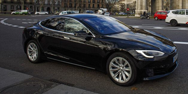 A Tesla Motors Inc. Model S electric automobile, operated Uber Technologies Inc., drives past the Puerta...