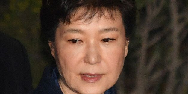 Ousted South Korean President Park Geun-hye, leaves after hearing on a prosecutors' request for her arrest...