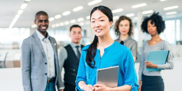Japanese business woman manager of a multiracial business