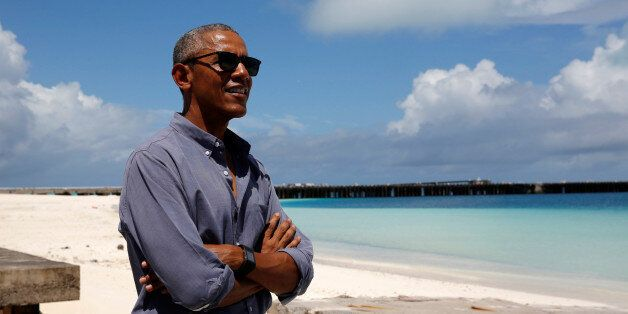U.S. President Barack Obama smiles as he looks out at Turtle Beach on a visit to Papahanaumokuakea Marine...