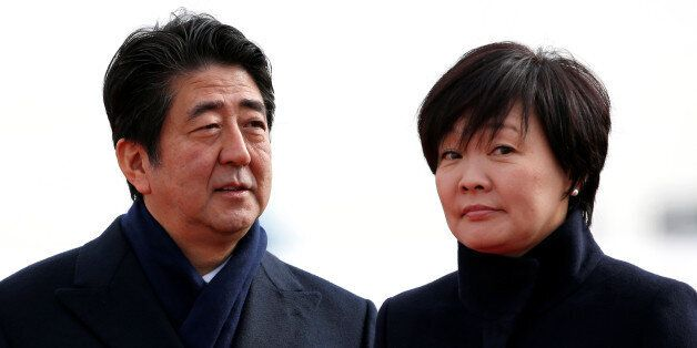 Japan's Prime Minister Shinzo Abe and his wife Akie are pictured at Tokyo's Haneda Airport, Japan January...