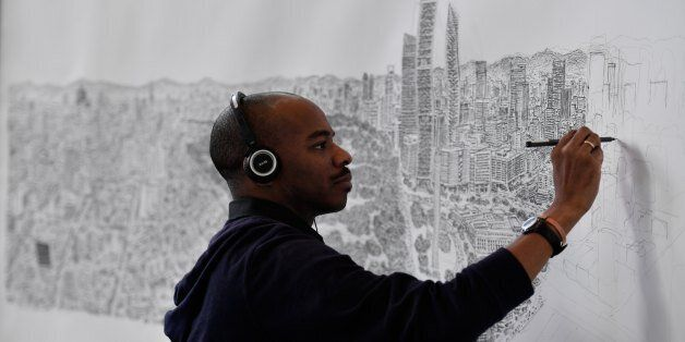 British artist Stephen Wiltshire draws freehand a panoramic view of Mexico City, in the Mexican capital,...