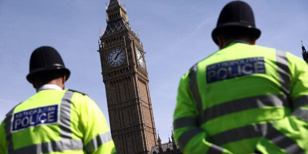Police officers patrol in Parliament Square following the attack in Westminster earlier in the week,...
